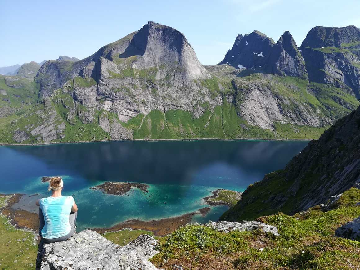 Hiker contemplating the view in the Lofoten