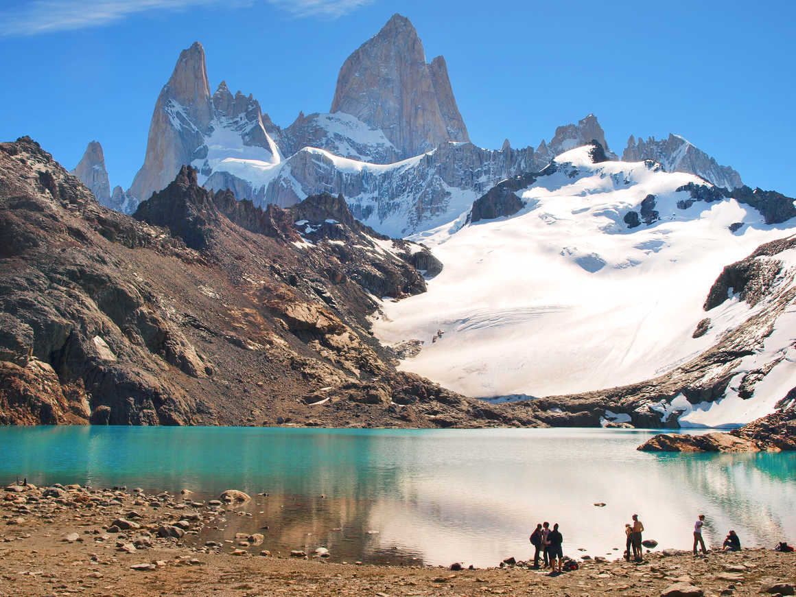 Hikers in front of a lake in El Chalten National Park