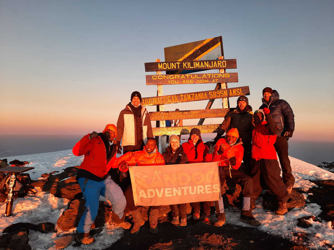Kandoo guides and climbers on the summit of Kilimanjaro
