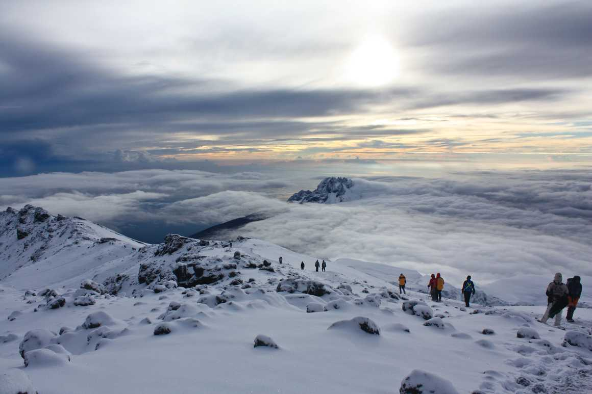 Sunrise above the clouds at Kilimanjaro summit