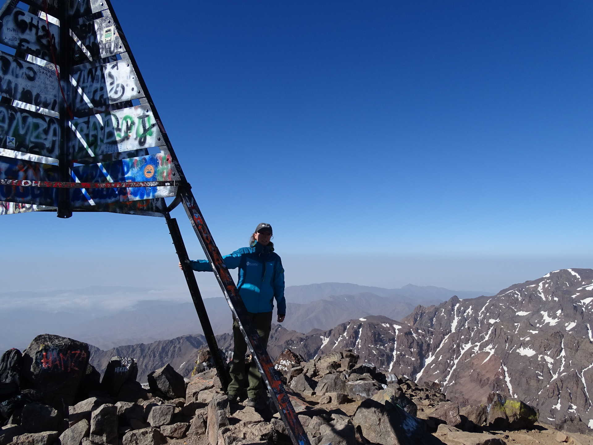 Hiker at the summit of Mount Toubkal
