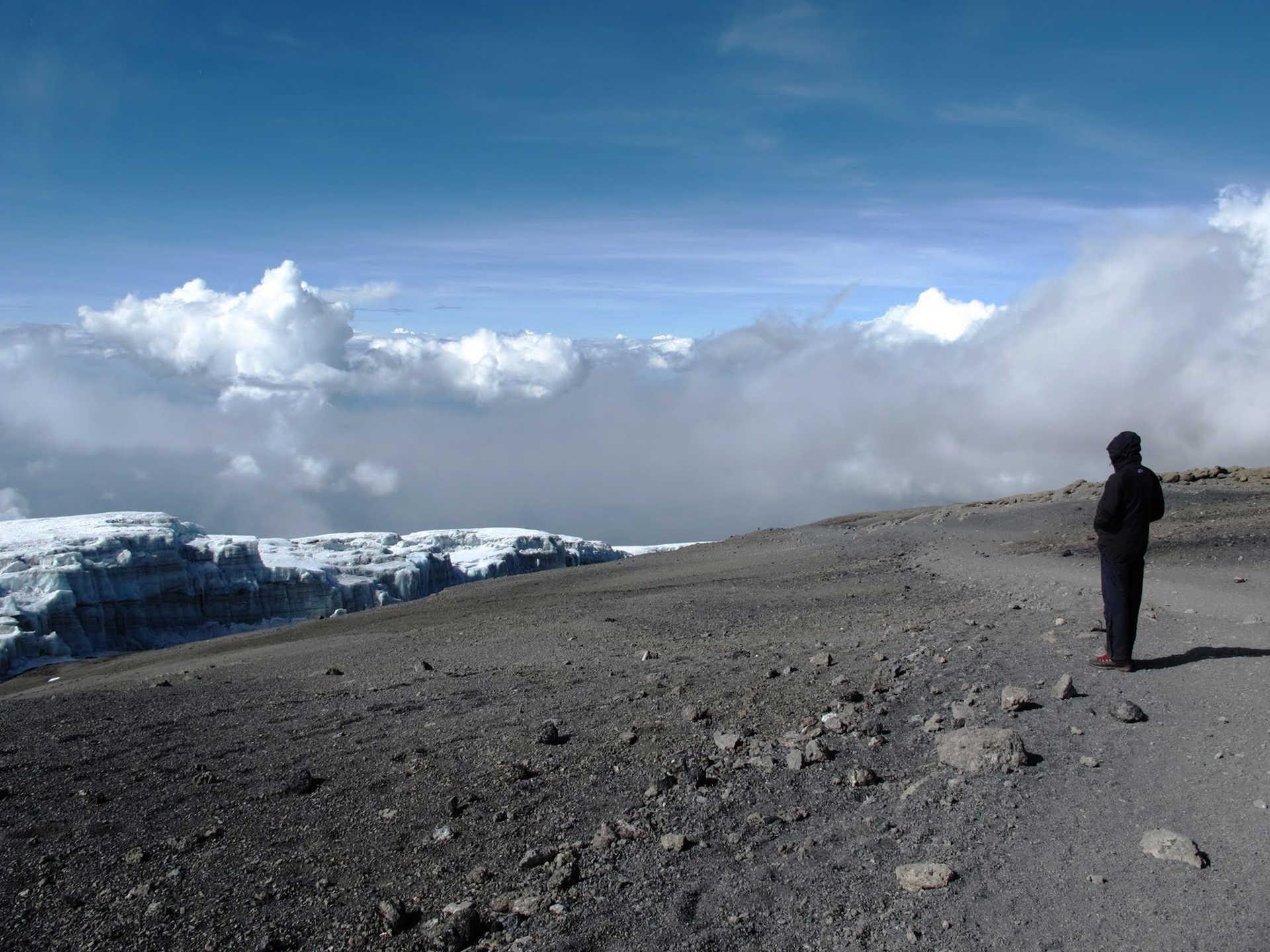 Hiker on the summit of Kilimanjaro