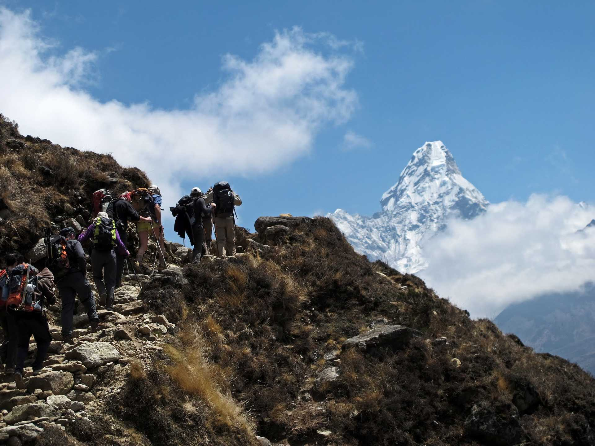 Hikers in front of Ama Dablam