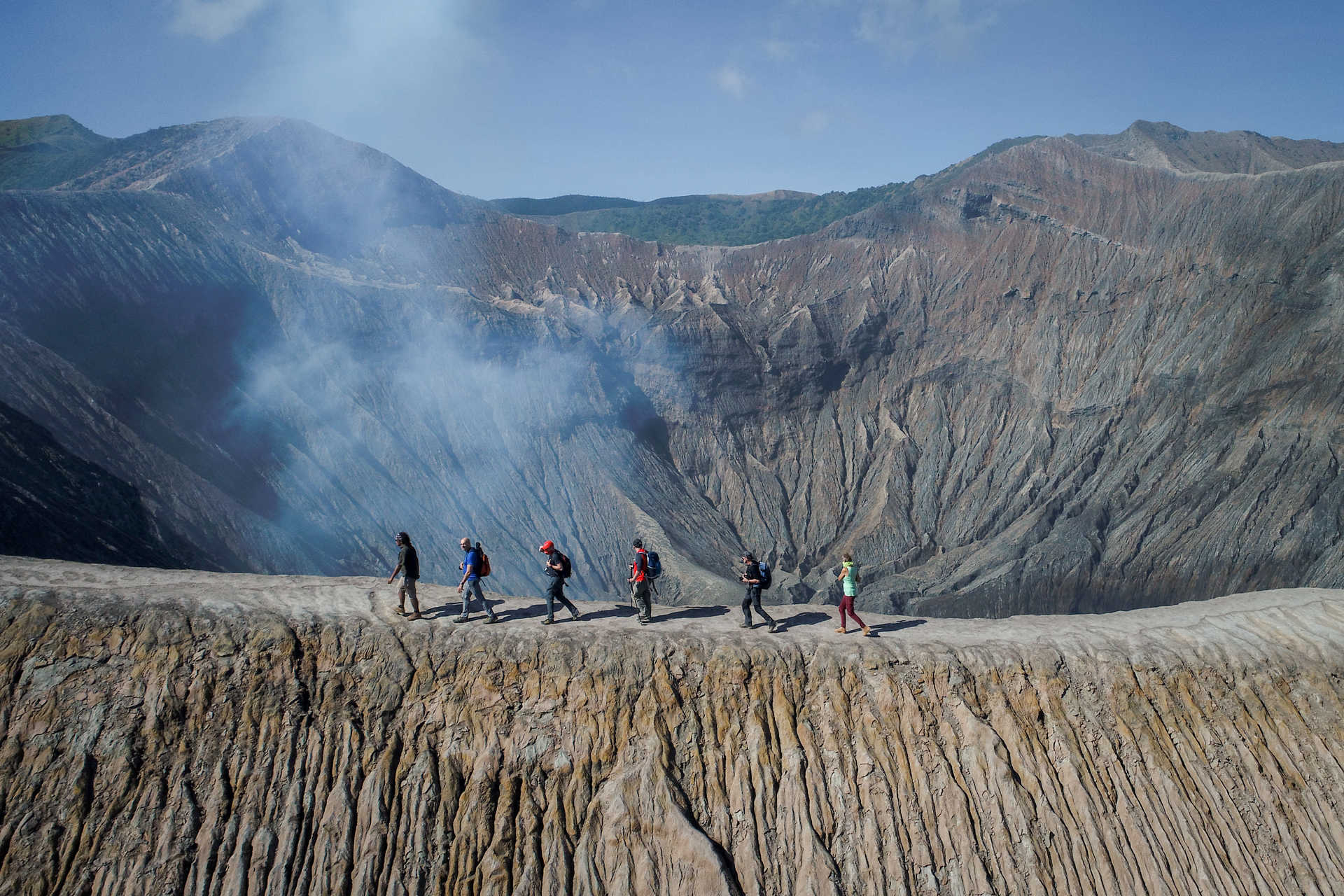 Hikers walking on the Bromo vulcano, Java
