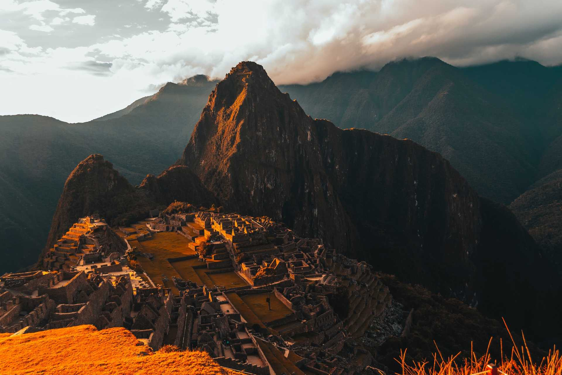 Machu Picchu bathed in orange light