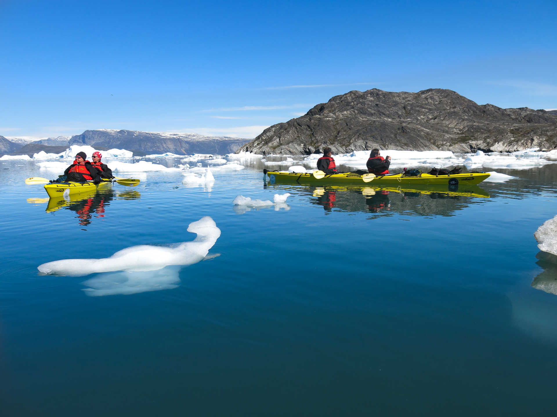 Sea-kayaking among icebergs in Greenland