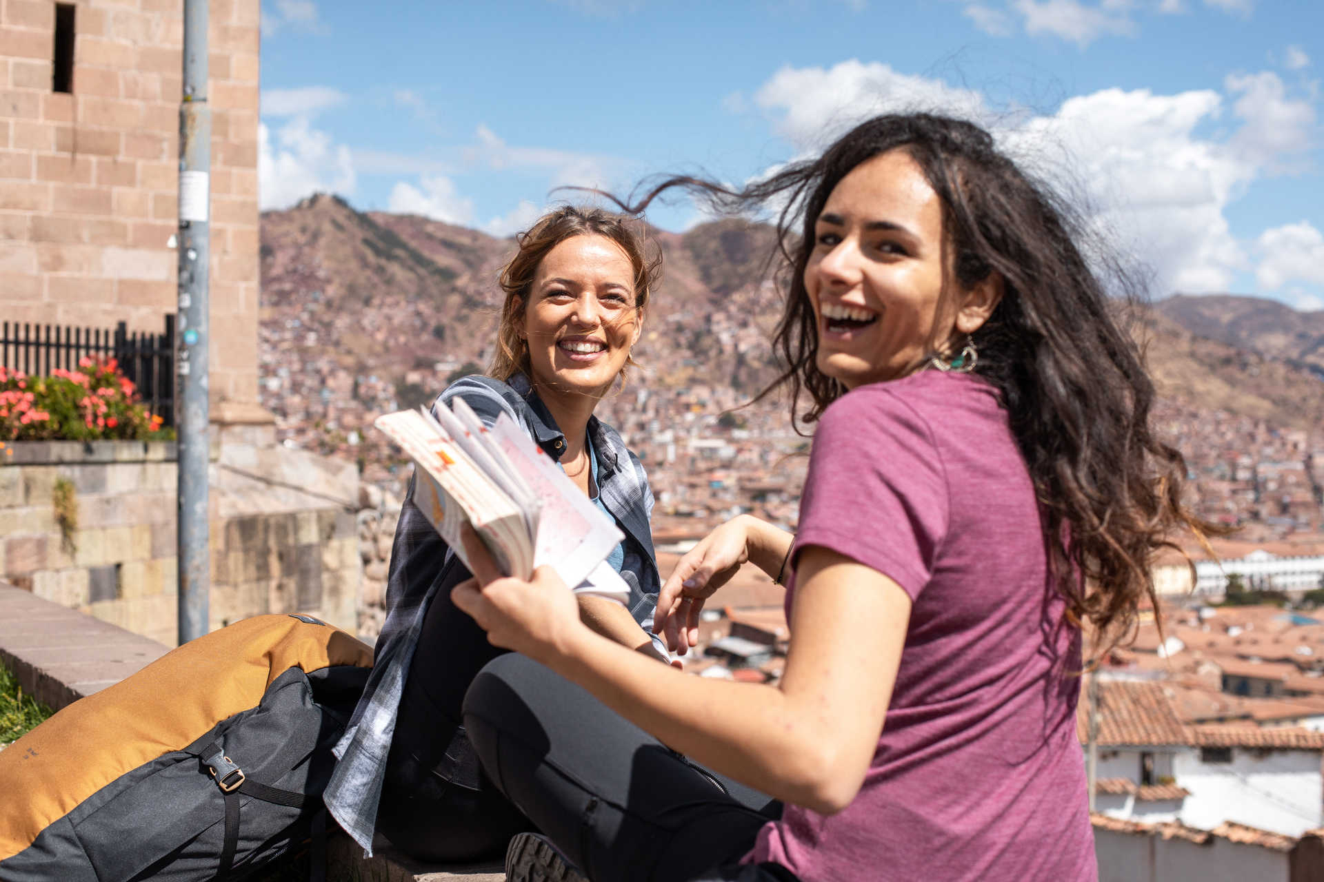Travellers reading a guide in Cusco