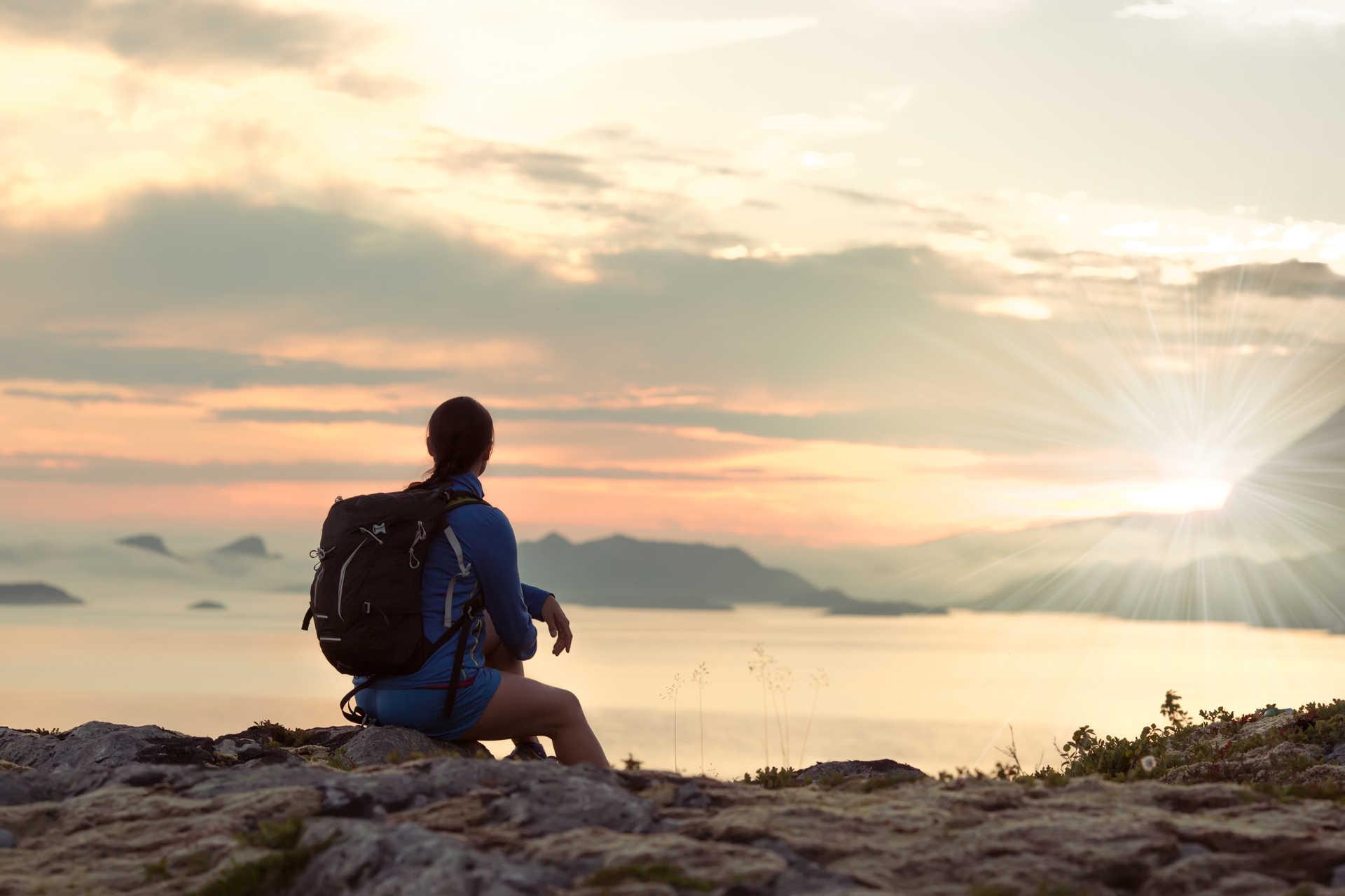 Trekker enjoying the sunset in Lofoten