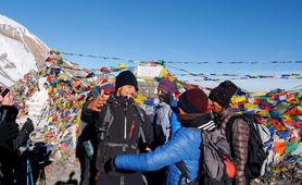 Trekker's hug when reaching a summit on the Annapurnas Circuit