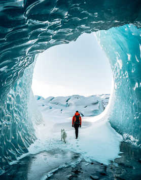 Hiker in a ice cave in Iceland