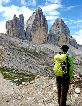Hiker in front of the Tre Cimes, Dolomites
