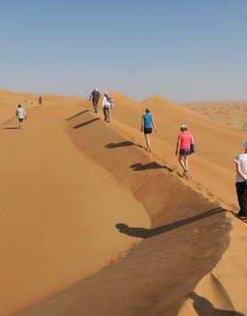 Hikers in Wahiba desert