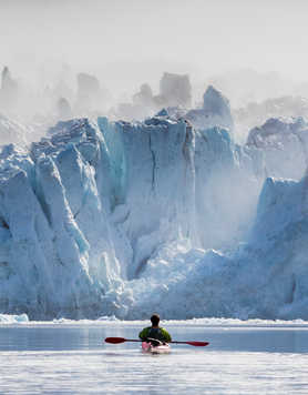 Kayak in front of glacier in Arctic