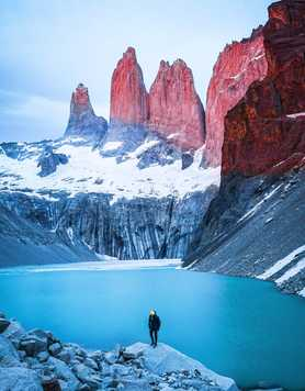 Man standing on rock in Torres del Paine National Park
