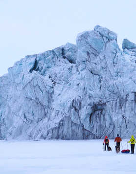 Skiing on ice floe in Spitsbergen at the foot of glacier