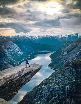 Trekker standing on Trolltunga