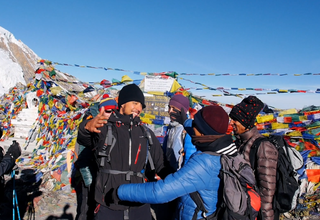 Trekker's hug when reaching a summit on the Annapurnas Circuit
