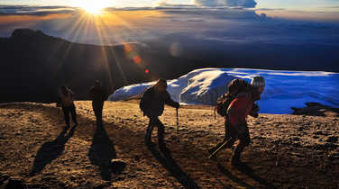 Group of hikers arriving at the Kili summit