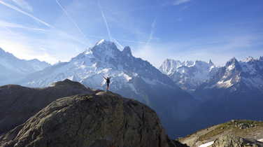 Hiker in front of the Mont Blanc massif