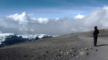 Hiker on the summit of Kilimanjaro