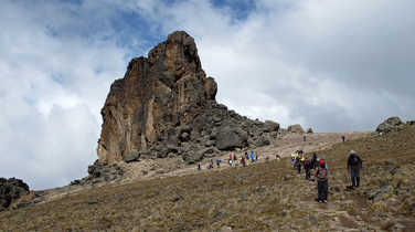 Hikers climbing to the Lava Tower