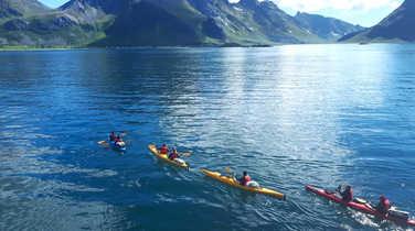 Sea kayaking in Lofoten islands during summer