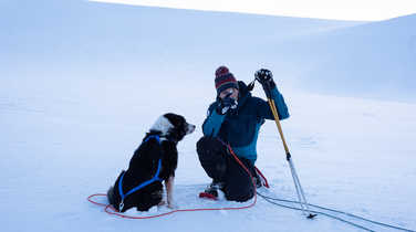 Talk with husky in Svalbard