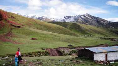 Tiny village un the valley beside the Rainbow Mountain