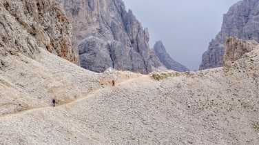Trekkers ascending a high pass in the Dolomites