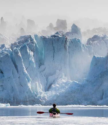 Kayak in front of glacier in Arctic