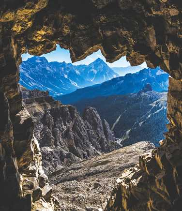 View out of cave to Dolomite peaks