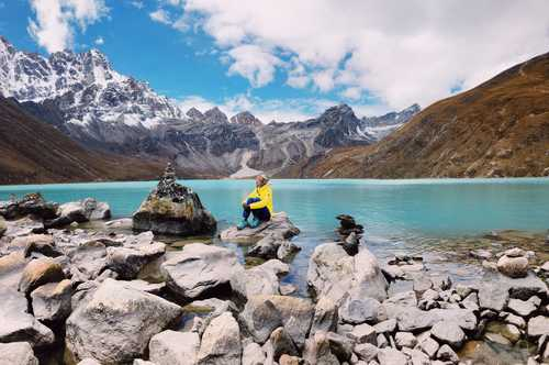 Hiker in front of Gokyo lake, Nepal