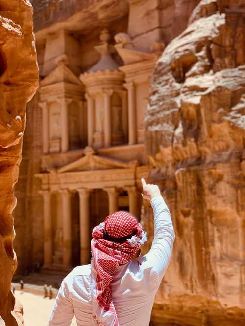 Man pointing at Petra