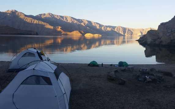 Camp in a Musandam fjord shore