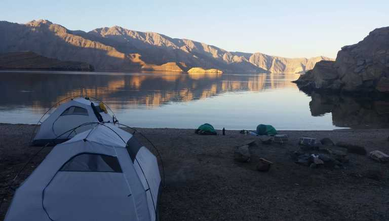 Camp in a Musandam fjord shore