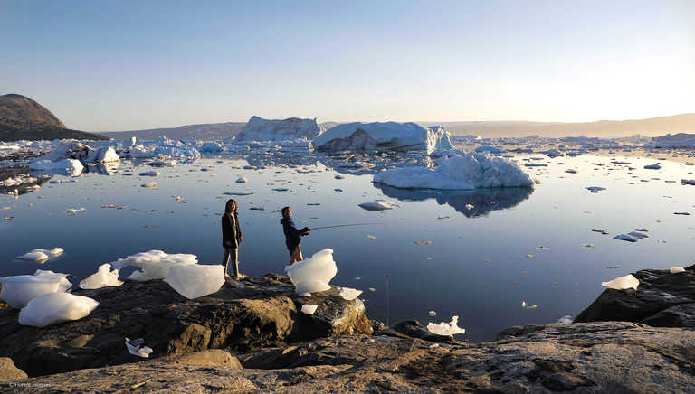 Fishing among icebergs in Greenland