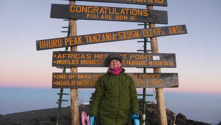 Happy hiker at Kili summit