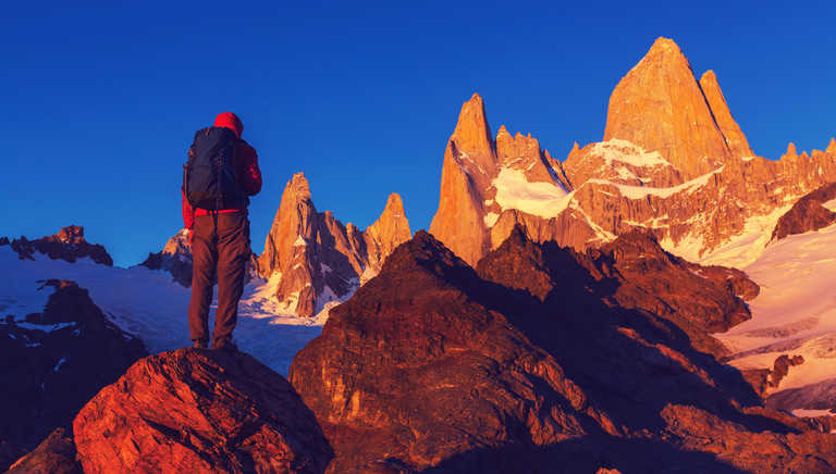 Hiker at sunrise in El Chalten National Park