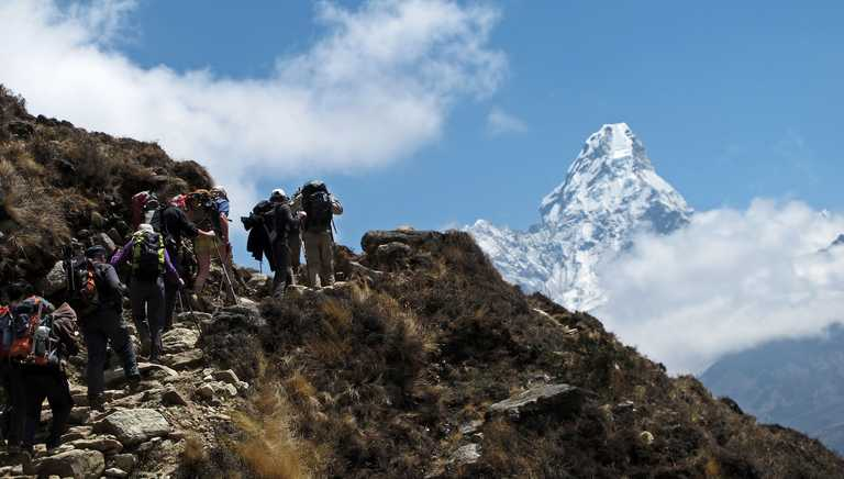 Hikers in front of the imponent mount Ama Dablam