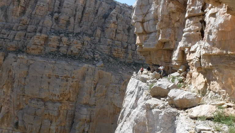Hikers walking in the impressive cliffs of Musandam