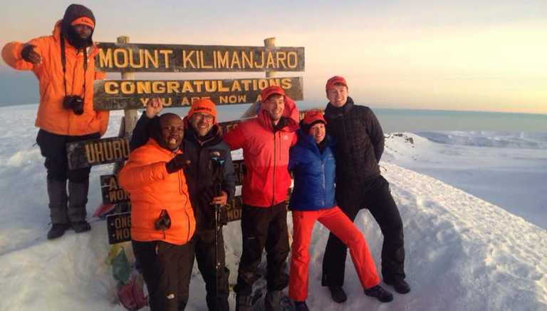 Kandoo team at the summit of Mount Kilimanjaro