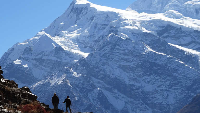 Silhouette of hikers in Annapurnas II