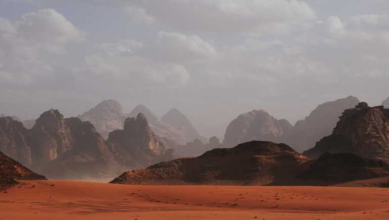 View of distant rocky peaks in the desert