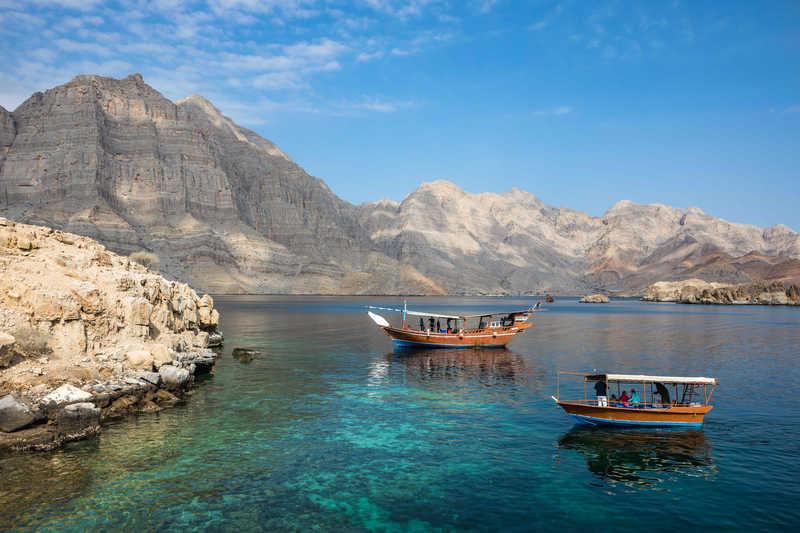 Boat in arabic fjord in Musandam fjord