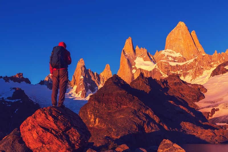 Hiker at sunrise in El Chalten National Park