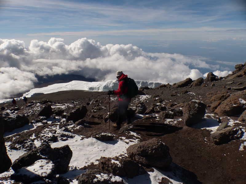 Hiker at the summit of Kilimanjaro