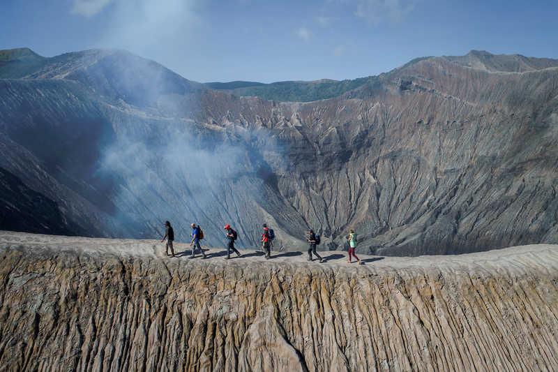 Hikers walking on the Bromo vulcano, Java