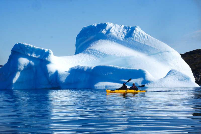 Sea kayaking among icebergs