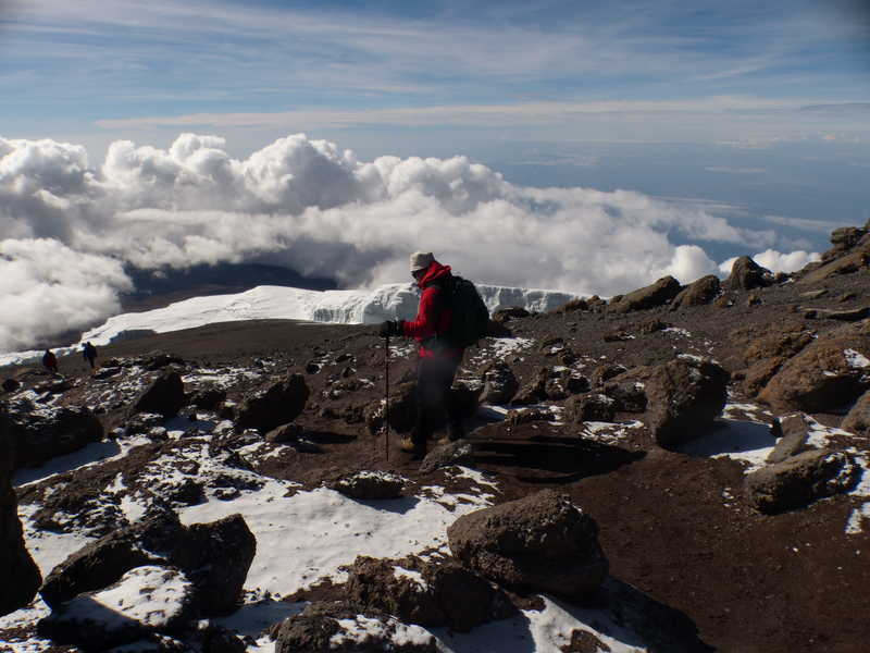 Hiker at the summit of Kilimanjaro