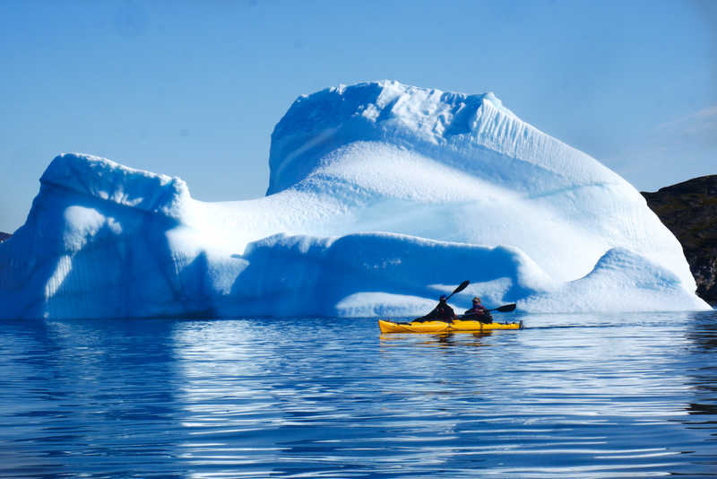 Sea kayaking among icebergs